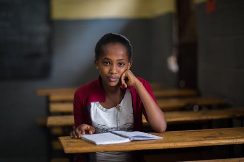 A girl sits at a desk, Ethiopia