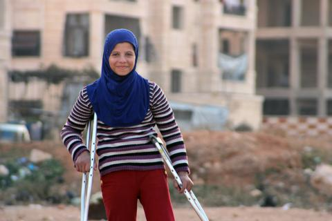 A girl on crutches, Syria