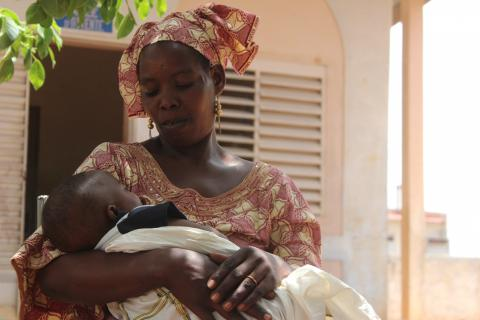 A woman breastfeeds her baby, Mali