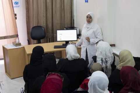 A UNICEF-supported health worker who delivers awareness sessions on infant and young child feeding practices in Damascus.