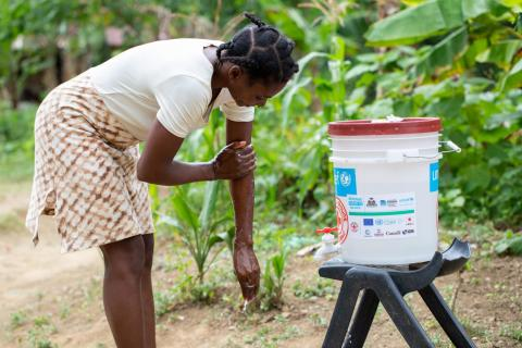 Haiti. A woman washes her hands to prevent against coronavirus.