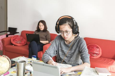 In Beijing, China, Xiaoyu studies at home while her mother also works remotely