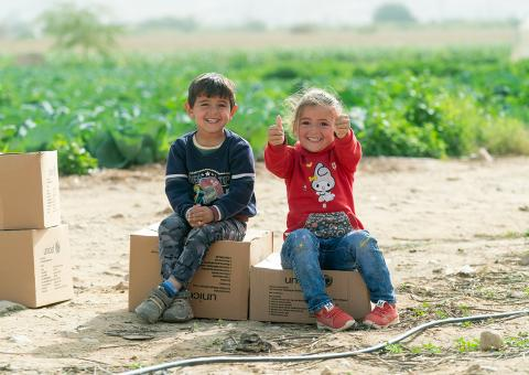 Young Syrian children, who came to Jordan with their family six years ago, received their winter clothing kits from UNICEF and its partner Mateen.