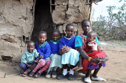 Mary Oloiparuni with her children at their home