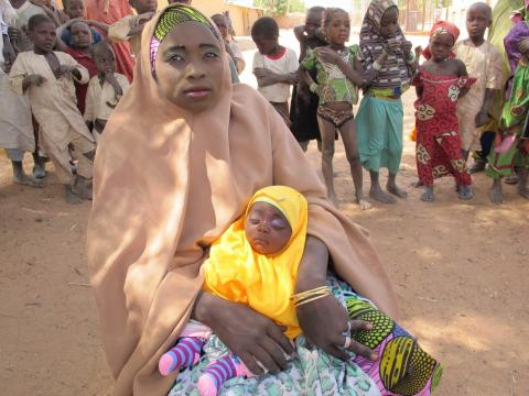 Masa'uda Abdullahi holds her daughter Rahama in Kebbi State, north-western Nigeria.