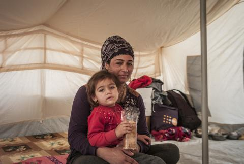 Iraq. A mother and her daughter sit in a tent in a camp in Iraq.