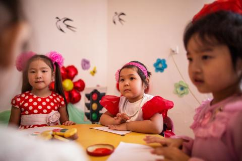 Five hear old surrounded by a group of children in her kindergarten 'Bopezhan' in Kyzylorda, Kazakhstan.