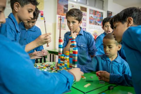 Children in Jordan play with LEGO