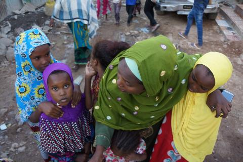 A woman gathers with children, Djibouti