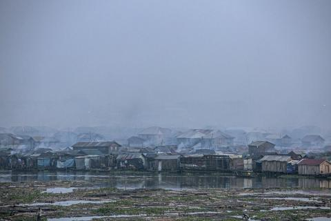 Smog covers Makoko, a fishing community mostly made up of structures on stilts above Lagos Lagoon, in Nigeria.