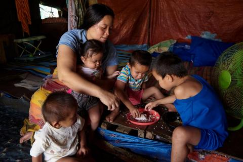 Philippines. A family eats at home.