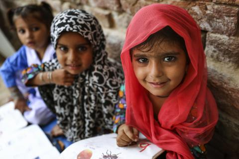 Alisha attending a class at a UNICEF supported Accelerated Education program (AEP) center in Punjab province, Pakistan.
