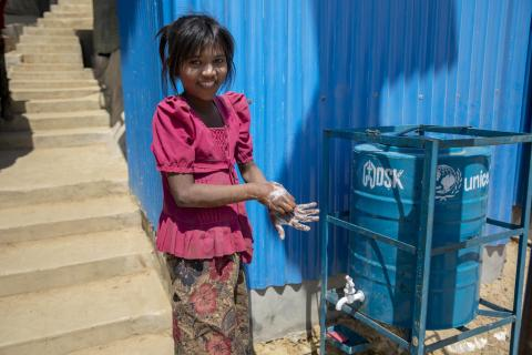 Bangladesh. A Rohingya child washes her hands.