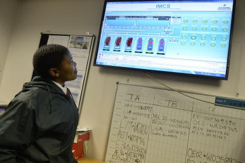 Nomonde looks at a review of maintenance procedures on a screen in the control rooms at OR Tambo International Airport.