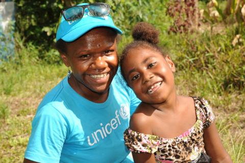 Tamanu smiles with a UNICEF staff member.