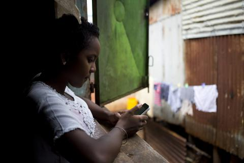 A 16-year-old girl in Madagascar browses the Internet.