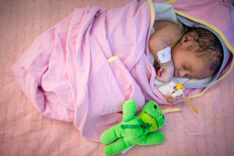 A newborn infant receives specialised care at the UNICEF-supported Neonatal Intensive Care Unit.