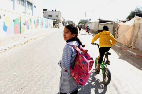 A girl wearing a pink backpack, Gaza, State of Palestine