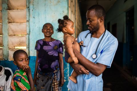 A doctor holds a child in his arms in the Kasai region, Democratic Republic of the Congo (DRC)