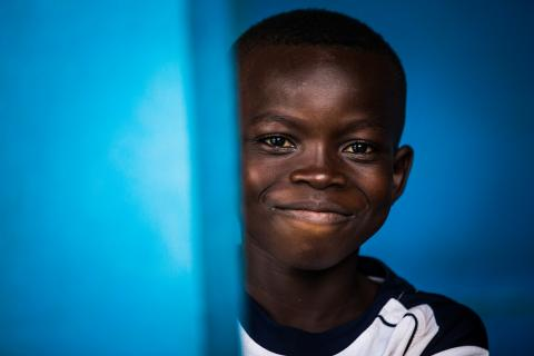 A boy who accompanied his brother to the Presbyterian Hospital stands in a corridor in Mbuji-Mayi, Kasaï region, Democratic Republic of the Congo.