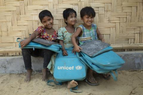 Bangladesh. Rohingya girls sit outside a UNICFE-supported learning centre.