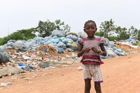 A girl playing in a landfill, Côte D'Ivoire
