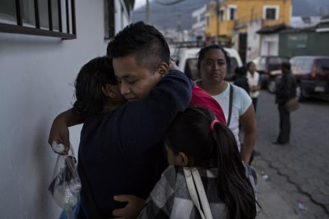 Guatemala. A boy hugs his mother after being reunited.