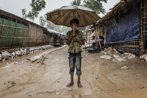 A boy stands in a Rohingya refugee camp in Bangladesh
