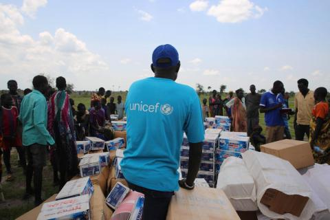 Samuel Amule, UNICEF Health Specialist checking over the UNICEF supplies in New Fangkak South Sudan during the RRM mission.