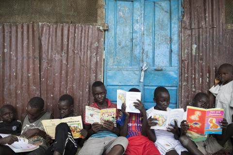 South Sudan. Children sit in a child friendly space in South Sudan