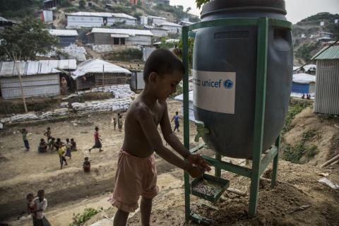 Bangladesh. A boy washes his hands in Cox's Bazar district.