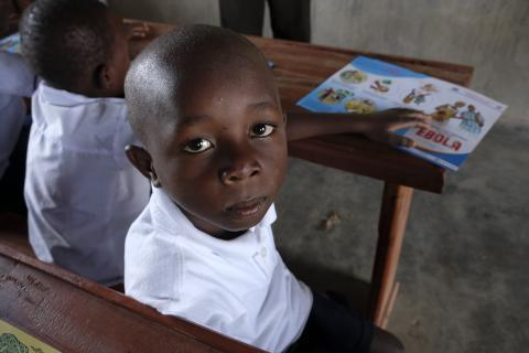 Democratic Republic of Congo. A child sits in a classroom.