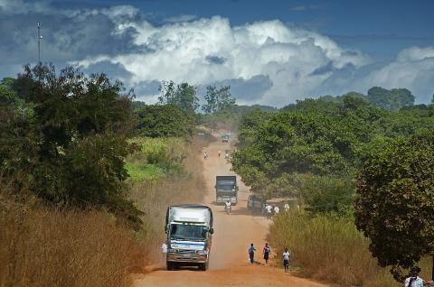 Trucks and other traffic on the dirt road to Ribaue, Mozambique.