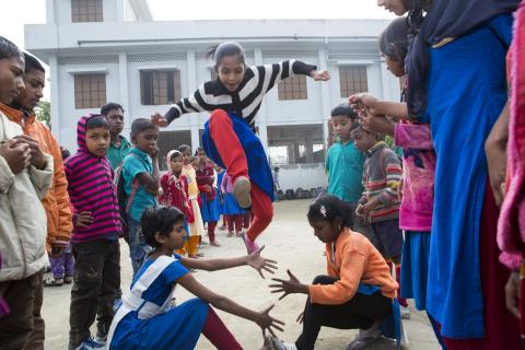 Convention on the Rights of the Child: A group of children play in a school playground in Bangladesh.
