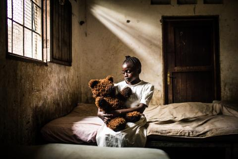 Marie, 13, holds a teddy bear at a Transition and Orientation Centre in Kananga, the capital city of the Kasai-Central Province in the Democratic Republic of the Congo (DRC).