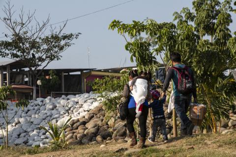 A family crosses the Suchiate River at the Mexico-Guatemala border.