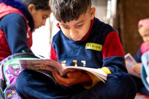Syria. A Syrian child reads in Jordan.