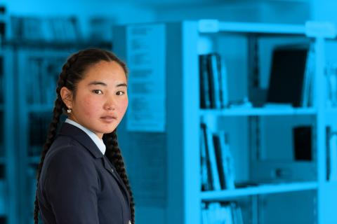 Adolescent girl in a library, in Bayan-Uul, Gobi-Altai province, Mongolia.