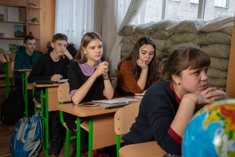 Eighth-grade students in Mariinka school No.2: Dasha,13, Hrysha,12 and Maria, 13, attend the family support center set up by UNICEF and partners to help children and their families endure the hardship of the conflict.
