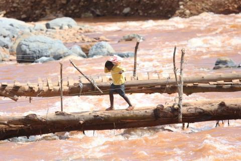 Zimbabwe. A boy walks across a bridge near where houses were swept away when Cyclone Idai hit.