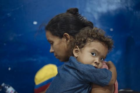 Colombia. A mother holds her child.