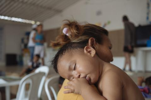 Baby with mother at child friendly space in Cucuta