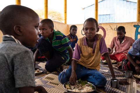 Children eat school-provided lunch at Qanshalay Primary School in Dollow, Somalia, Tuesday, April 23, 2018. Qanshaley Primary School is just one of many in the region supported by the World Food Programme (WFP) and UNICEF