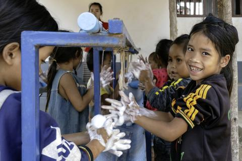 Lao. Children wash their hands.