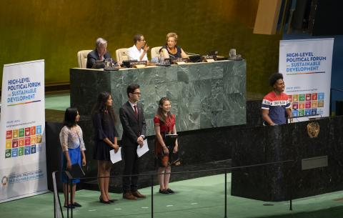 On 16 July 2019 in New York, (right) Darrius Simmons, 18, from the USA, addresses the General Assembly Hall of the United Nations Headquarters.