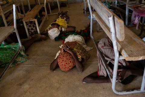 Burkina Faso. Children hide under desks.
