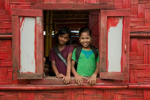 Bangladesh. Two girls look out of a window at a UNICEF-supported Learning Centre in Cox's Bazar.