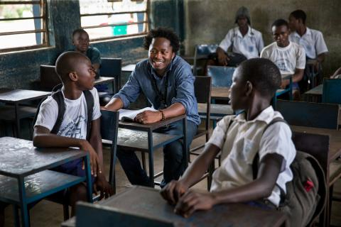 Ishmael Beah talks to students in a school