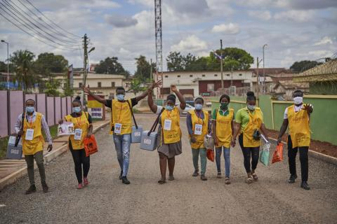 On 10 September 2020 in Ghana, a polio vaccination team shares a lighter moment with the photographer on their way back from a door-to-door polio vaccination campaign in Kumasi city, Ashanti region.