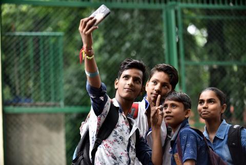 A group of teens take a selfie